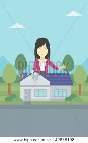 An asian young woman standing behind the house and showing thumb up. Female real estate agent offering the house. Young woman giving thumb up. Vector flat design illustration. Vertical layout.