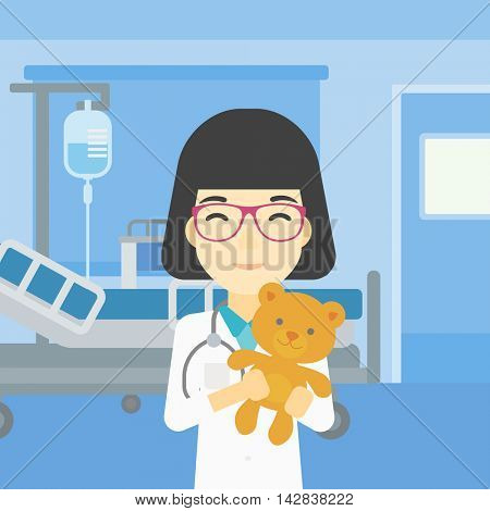 Young asian female pediatrician doctor holding a teddy bear. Professional pediatrician doctor with a teddy bear in the hospital room. Vector flat design illustration. Square layout.