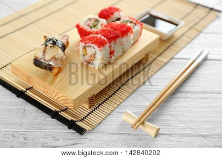 Delicious sushi set on wooden board