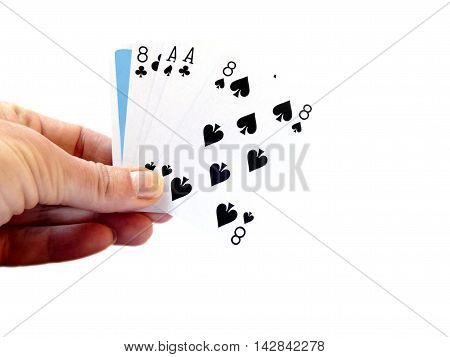 Hand Lifting Up A Dead Man's Hand, Two-pair Poker Hand Consisting Of The Black Aces And Black Eights