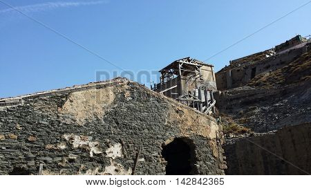 Old deserted miners town in Argentiera with blue sky