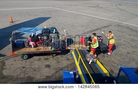 HERAKLION GREECE - 08.10.2016: airport plane luggage loading team