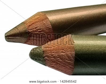 Part Of Metallic Cream Eyeshadow Pencils Green Brown Closeup Isolated On White. Two-tone.