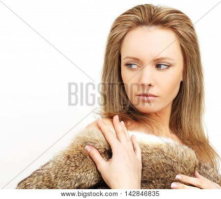 Fashion woman in fur pent-up passion on white