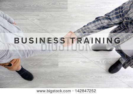 Business training concept. Two men shaking hands