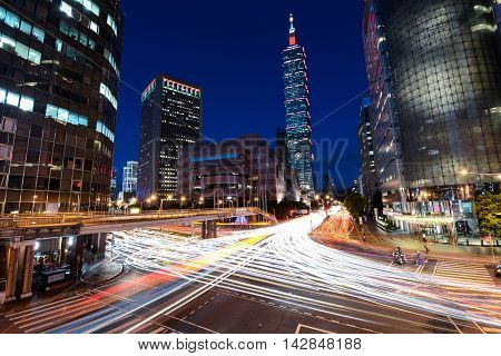 TAIPEI, TAIWAN - AUGUST 15, 2016 - Rush hour traffic speeding through a busy intersection near Taipei 101 in the capital of Taiwan