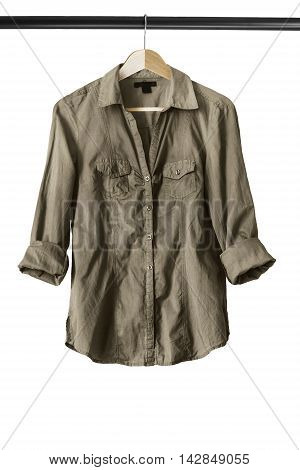 Khaki shirt on wooden clothes rack isolated over white