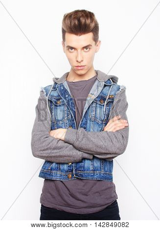 young fashion male posing in studio