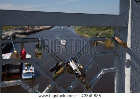 Fasten locks on the bridge of lovers
