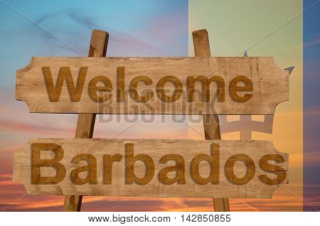 Welcome To  Barbados Sing On Wood Background With Blending National Flag