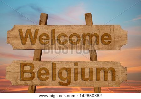 Welcome To  Belgium Sing On Wood Background