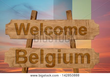 Welcome To  Belgium Sing On Wood Background With Blending National Flag