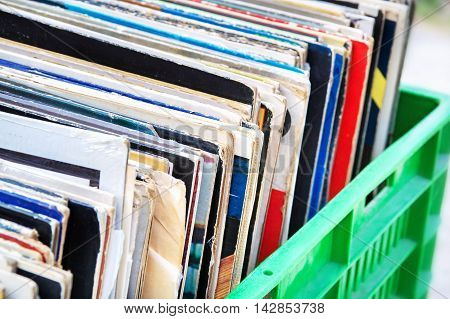 Various Vinyl records in green box closeup
