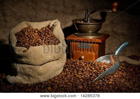 Sack Of Coffee Beans, Coffee grinder And Metal Scoop Still Life