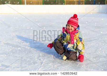 happy little girl skating in winter, kids winter sport