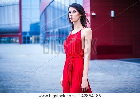 Sexy young beautiful woman in red dress