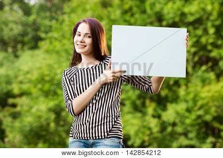 Woman Holding Blank Banner
