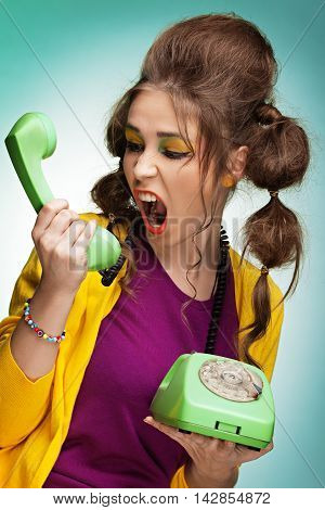 Young pretty woman screaming on the phone