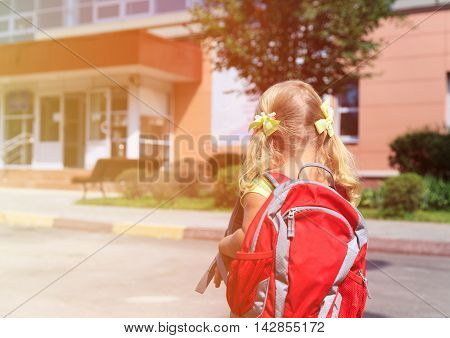 Back to school - little girl near preschool or daycare