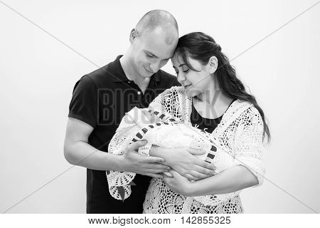 Happy Family Holding Their Newborn Baby In Her Arms.black And White Photography