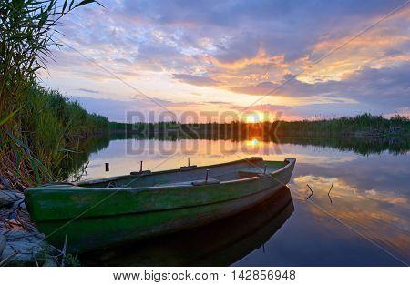 Fisherman boat on Danube Delta at sunset