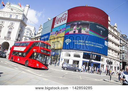 Bus Drives Past Large Screen Tv In Piccadilly Circus