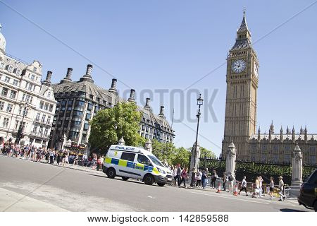 Police Van Drive Past Big Ben In Westminster
