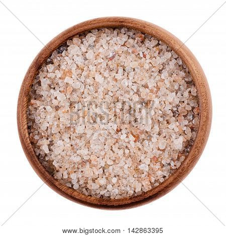 Natural red rock salt in a bowl on white background. Rough grained and edible sodium chloride, NaCl, also halite, from a salt mine in Salzburg, Austria. Isolated, macro photo and close up from above.