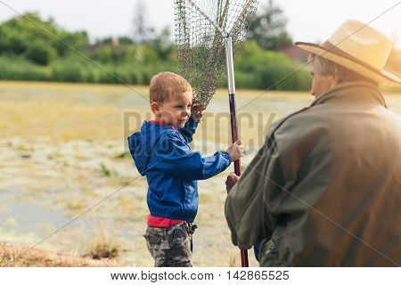 Grandfather with  grandson enjoyed on the fishing.