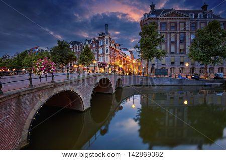 Amsterdam. Image of Amsterdam, Netherlands during dramatic sunrise.