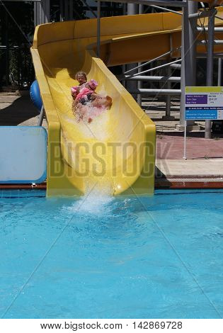 18TH JULY 2016, CALIS,TURKEY; A mother and daughter having fun on a water slide in a waterpark in Calis, in Turkey, 18th july 2016