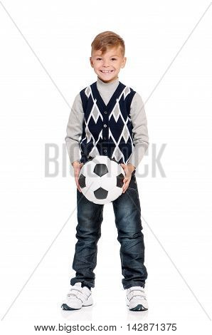 Happy schoolboy with soccer ball isolated on white background