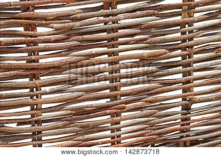 the old Ukrainian traditional wood wicker fence