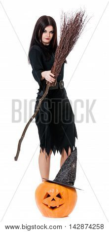 Young sexy witch with broom isolated on white background cutout