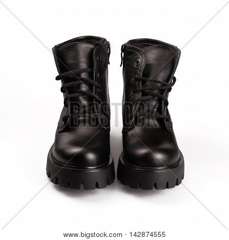 Fashion black winter boots in a white background