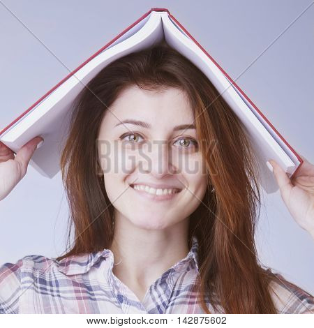 Young Student Girl Balancing Books on her Head
