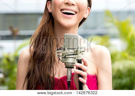 Close-up Of Happy Singer Smiling And Performing A Gig