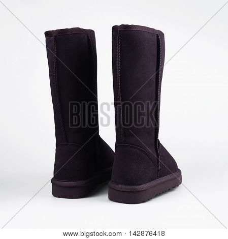 female Fashion winter boots in white background