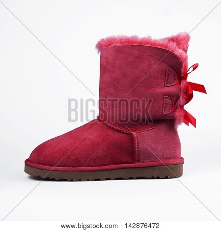 Red boots for winter in white background
