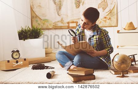 child boy teenager studying a map of the world globe geography dreams of travel