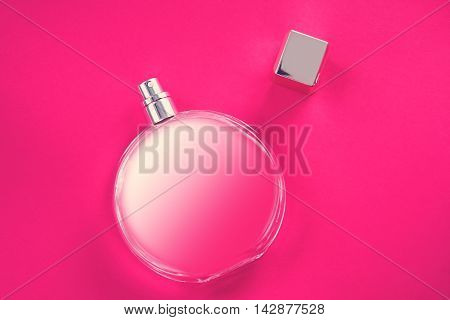 stylish bottle of perfume over pink background