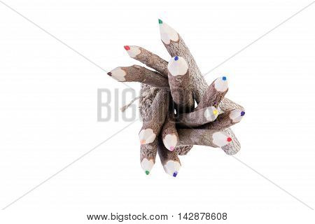 Top down view on green red and blue colored pencils with brown tree bark coating or finish over white background