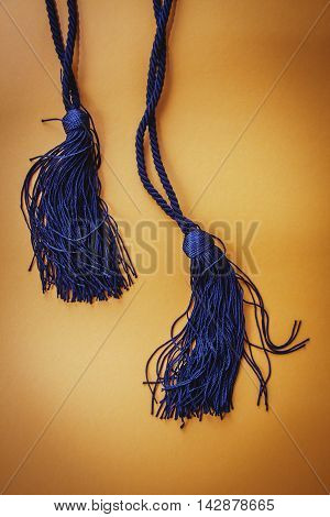Textile and tassels isolated on yellow background