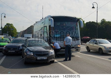 ST. PETERSBURG, RUSSIA - JULY 28, 2016: Traffic accident on the Admiralty embankment. A tour bus collided with a passenger car