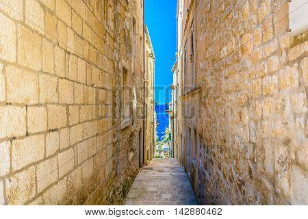 Mediterranean narrow stone street in old city center of town Korcula, Croatia.
