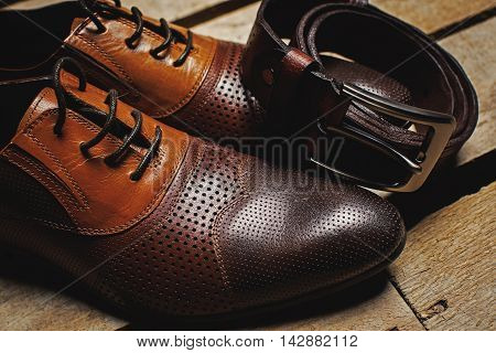 Men's accessories. stylish brown shoes and belt