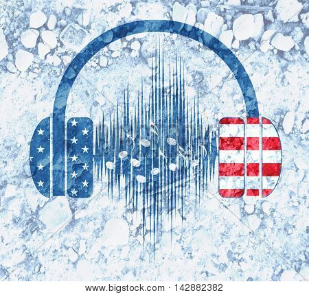 Silhouettes of headphones with sound wave. Textured by USA flag. Scattering of stones backdrop