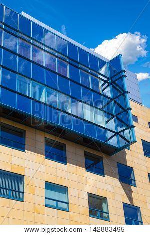 Modern office building facade against the blue sky.