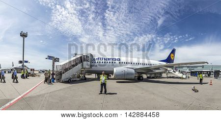 People Board The Lufthansa Flight With Position At The Apron Due To Shortage Of Gates At Terminal.