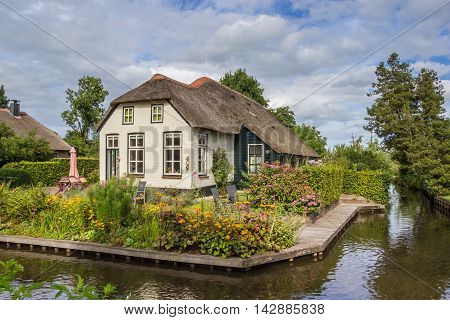 White farm house with thatched roof in Giethoorn Netherlands